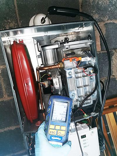 A Worcester Bosch gas boiler being serviced by Shepley Heating